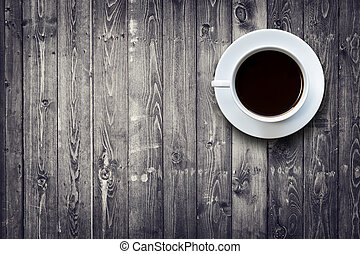 White coffee cup on wooden table top view - Close up white...