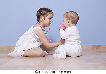 Brothers playing doctor with stethoscope