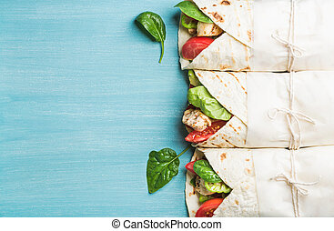 Healthy lunch snack. Tortilla wraps with grilled chicken...