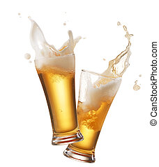 toasting - two glasses of beer toasting creating splash