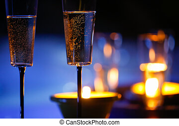 Candlelit champagne glasses beside a jacuzzi - Extravagant,...
