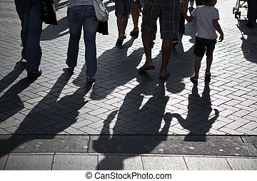 Group of people walking - People crossing the street in...