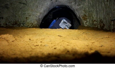 Cavers go in old adit for extraction of sand - Cavers...