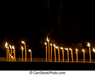 flames of candles in the wind