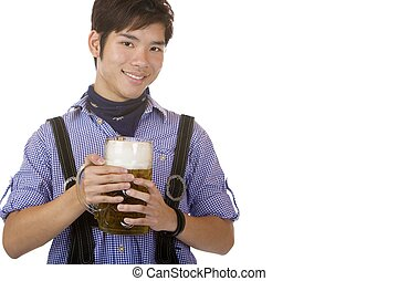 Young Asian man holding beer stein - Young Asian man in...