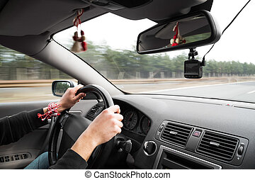 Passenger point of view on driver with hands on steering...