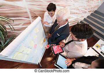 business people group brainstorming and taking notes to...