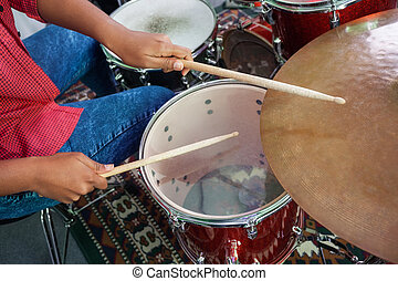 Midsection Of Female Drummer Performing