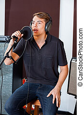 Young Male Singer Performing In Studio