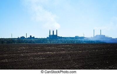 metallurgical works- pipes and a smoke against the blue sky