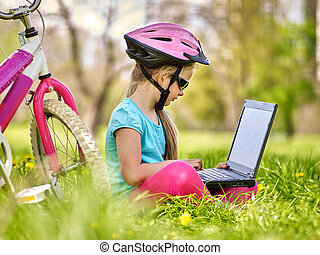 Bikes cycling girl wearing helmet in cycling sitting near...