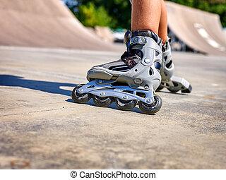 Girl riding on roller skates - Roller skate legs close up in...
