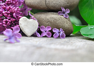 little heart and lilac - little heart on pebbles with petals...