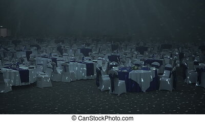 Empty restaurant with covered tables - The beginning of the...