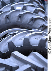 big tyres for large machines in a row at an agriculture show...