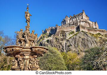 Edinburgh castle with fountain in Scotland