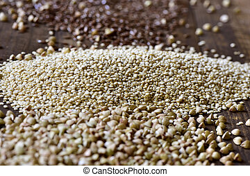 buckwheat, quinoa and brown flax seeds - closeup of some...