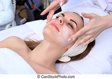Cleansing peeling at the beauty salon. - Beautician makes...