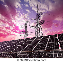 Solar panels with electricity pylons at sunset. Clean energy...