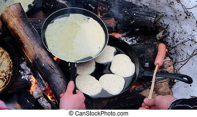 Traditional food. Russian pancakes over an open fire -...