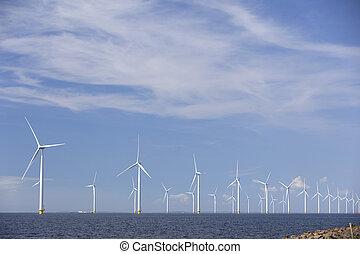 wind turbines in water of ijsselmeer off the coast of...