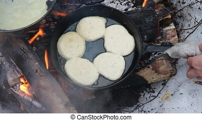 Traditional food Russian cuisune: pancakes over an open fire...