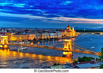 Szechenyi Chain Bridge and Parliament at dusk. Budapest,...
