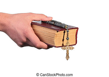 Old bible with a cross