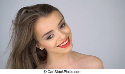 Beautiful happy woman with red lips