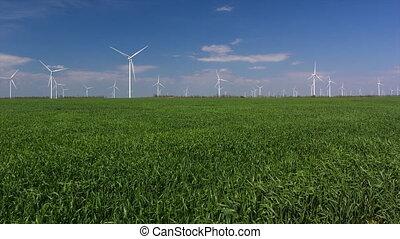 wind turbines against blue sky. Tme lapse.