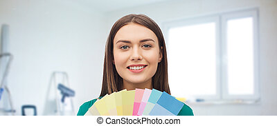 smiling young woman with color swatches - repair,...