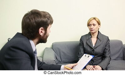 man will interview business woman. report to the Chief - man...