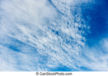 Beautiful blue sky with scattered clouds