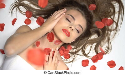 Beautiful woman with rose petals - Brunette beautiful woman...