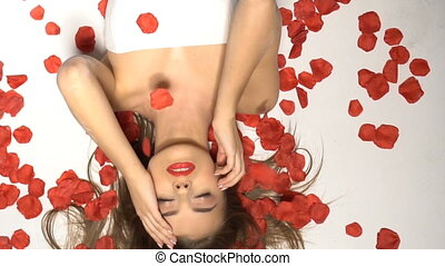 Beautiful woman with rose petals - Brunette beatiful woman...