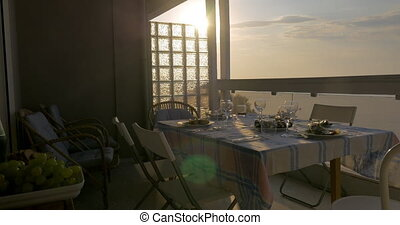 Woman serving dinner on the home balcony