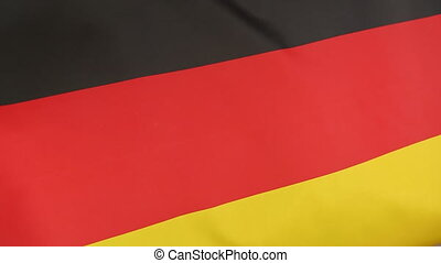 Closeup of German national flag in the wind