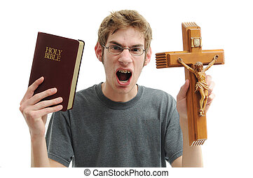 Bible Thumper - Young man holds up a wooden crucifix cross...