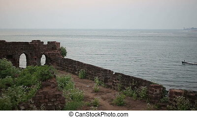 Ruins of the fortress on the sea shore - Ancient ruins of...