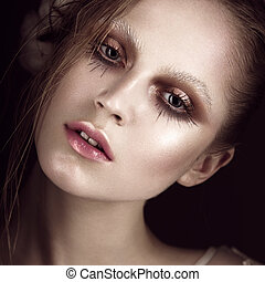 Art fashion girl with creative makeup. Beauty face.