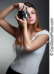Photographer girl shooting images Attractive blonde woman...