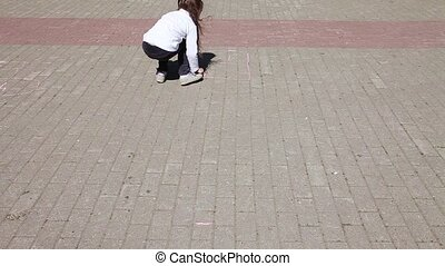 Little girl playing hopscotch - Fast motion video shot of a...