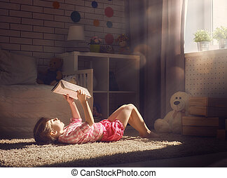 girl reading a book - Cute little child girl reading a book.