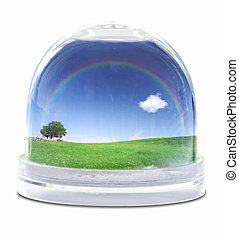 Snow globe with green grass field, blue sky fully white...