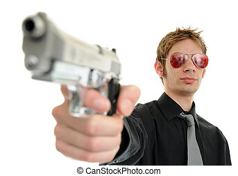 Gunpoint - Young man holding up a gun with the focus on his...