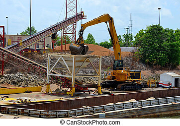 Gravel being unloaded from barge - Sand, gravel, rocks being...