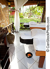 Place for relaxation in authentic asian wellness center Tropical outdoor background