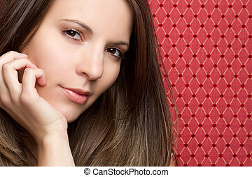 Pretty Young Woman - Pretty young woman on red background