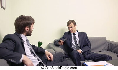 Two businessman emotionally discuss plans teamwork two men