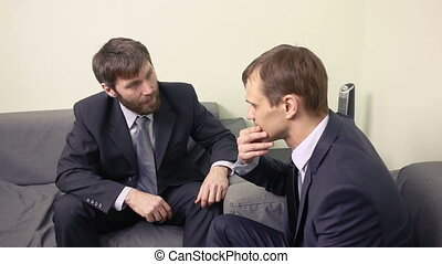 Two businessman emotionally discuss plans. teamwork two men.